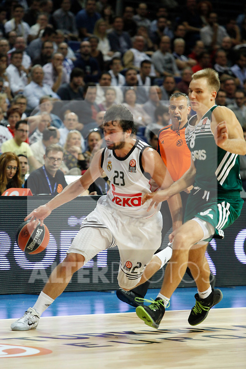Basketball Real Madrid´s Sergio Llull (L) and Zalgiris Kaunas´s Kariniauskas during Euroleague basketball match in Madrid, Spain. October 17, 2014. (ALTERPHOTOS/Victor Blanco)