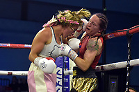 Kristine Shergold (black/gold/red shorts) defeats Kallia Kouroni during a Boxing Show at Bracknell Leisure Centre on 8th July 2018