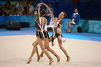 August 24, 2008; Beijing, China; Rhythmic group from Ukraine (here with Alina Maximenko) performs hoops + clubs routine in the group All-Around final at 2008 Beijing Olympics..(©) Copyright 2008 Tom Theobald