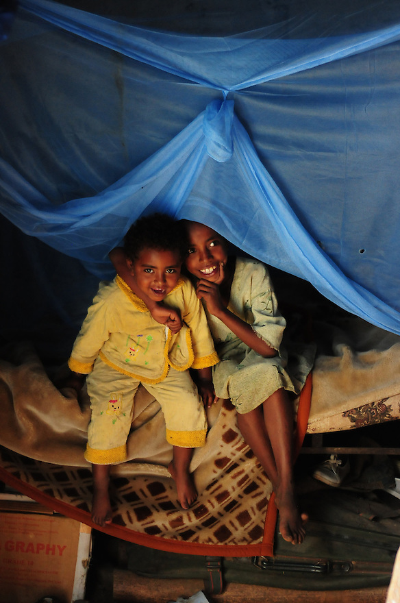 The Arake household is a Model Household, because they have implemented at least 10 of 16 elements to improve environmental elements and personal hygiene such as the use of bed nets, building ing separate shelter for livestock, use family planning and more. UNICEF offers support to the program though training health workers, who monitor progress. The Arake family children are pictured here under a bed net.