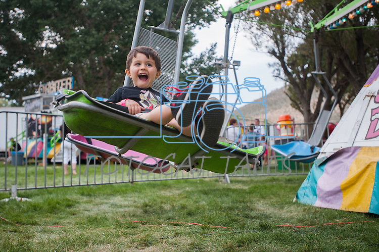 Kaleb Florence,3, laughs while riding a ride during the NV150 Fair at Fuji Park in Carson City, Nev., on Sunday, August 3, 2014.<br /> (Photo By Kevin Clifford)