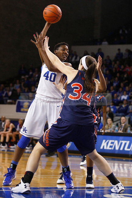 UK forward Brittany Henderson looks to pass the ball against Auburn center Peyton Davis during the second half of the UK Hoops vs. Auburn women's basketball game at Memorial Coliseum in Lexington, Ky., on Sunday, January 20, 2013. Photo by Tessa Lighty | Staff