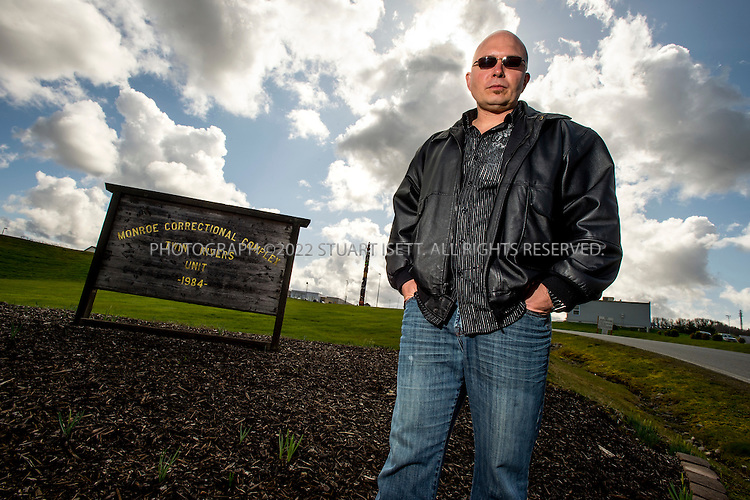 3/22/2012--Monroe, WA, USA..William Mulholland, a former Washington State and Federal prisoner who has served a total of 22 years in prison, including a 4 year stretch at the Monroe Correctional Complex (seen here behind) in Monroe, WASH., 45 minutes east of Seattle. Mulholland now lives up the road from the prison in Goldbar, WASH., where he runs his prison consultating business and advises people, who have been indicted, about life in prison and the bureaucracy of prison...©2012 Stuart Isett. All rights reserved.