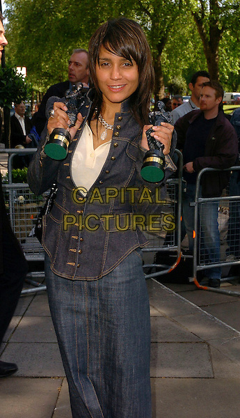 AMANDA GHOST.The Ivor Novello Awards at Grosvenor House, Park Lane, London, UK..May 25th, 2006.Ref: CAN.half length jean jean denim jacket skirt awards trophy trophies.www.capitalpictures.com.sales@capitalpictures.com.©Capital Pictures