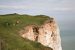 The sheer chalk cliffs at Beachy Head are a notorious suicide spot as illustrated by the memorial flowers and crucifixes on the cliff top, Sussex, England