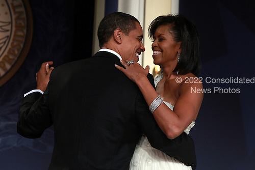 Washington, DC - January 20, 2009 -- United States President Barack Obama and his wife First Lady Michelle Obama dance on stage during MTV & ServiceNation: Live From The Youth Inaugural Ball at the Hilton Washington on January 20, 2009 in Washington, DC. President Barack Obama was sworn in as the 44th President of the United States today, becoming the first African-American to be elected President of the US. .Credit: Mark Wilson - Pool via CNP