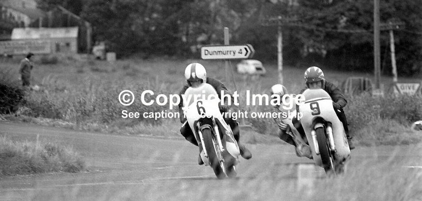 Ray McCullough, British, rider, racing motorcyclist on bike 9 leads a couple of other riders out of the hairpin at the Dundrod circuit, N Ireland. McCullough was competing in 1973 Ulster Grand Prix. Can you positively idenitify the other riders? If so please let me know. 197308180571RMC2.<br />
