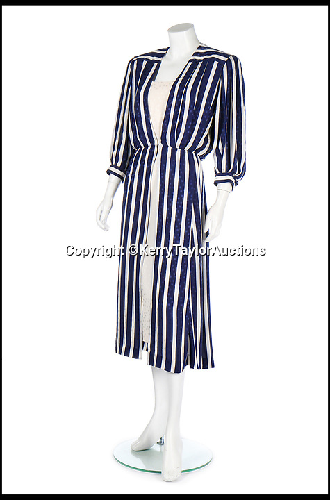 BNPS.co.uk (01202 558833)<br /> Pic:   KerryTaylorAuctions/BNPS<br /> <br /> The blue and white silk ensemble commissioned from the Emanuels sold for £106,000.<br /> <br /> Three designer dresses worn by Princess Diana for her Royal duties have sold for over £260,000.<br /> <br /> The trio of outfits included a blue and white striped dress commissioned from the Emanuels and worn by Diana during her visit to the Gulf states with Prince Charles in 1986. That sold for £106,000 alone.<br /> <br /> A Catherine Walker printed peach silk polka dot coat dress the Princess of Wales was seen out in on numerous occasions in the late 1980s and early '90s fetched almost £100,00 at the sale in London.