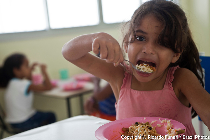 5/6-years old children enjoying heathy food, eating  rice and beans, Manaus, Amazonas State, North Brazil.