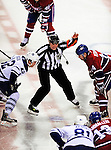 10 April 2010: NHL referee Dan Marouelli prepares to drop the puck to satrt his last career game officiating the final game of the regular season between the Toronto Maple Leafs and the Montreal Canadiens at the Bell Centre in Montreal, Quebec, Canada. The Leafs defeated the Habs 4-3 in sudden death overtime as the Canadiens advance to the Stanley Cup Playoffs with the single point. Mandatory Credit: Ed Wolfstein Photo