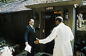 President Anwar al-Sadat of Egypt, right, and Prime Minister Menachem Begin of Israel, left, prepare to enter Aspen Lodge at Camp David, the US presidential retreat near Thurmont, Maryland for the first meeting of their summit to discuss a peace treaty between their two countries with United States President Jimmy Carter on September 6, 1978..Mandatory Credit: Karl Schumacher - White House via CNP