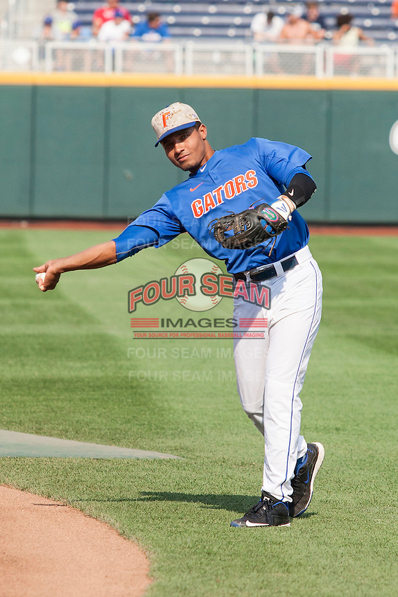 Florida Gators shortstop Richie Martin (12) warms up before Game 13 of the NCAA College World Series against the Virginia Cavaliers  on June 20, 2015 at TD Ameritrade Park in Omaha, Nebraska. The Cavaliers beat the Gators 5-4. (Andrew Woolley/Four Seam Images)