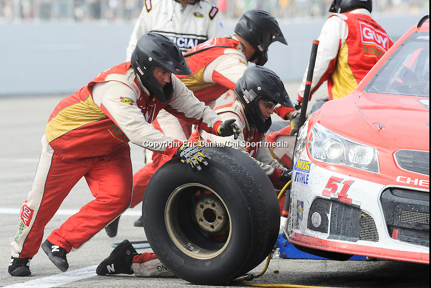 July 14, 2013 - Loudon, New Hampshire U.S. - A right front tire is changed on Sprint Cup Series driver AJ Allmendinger (51) car during the NASCAR Sprint Cup Series Camping World RV Sales 301 held at the New Hampshire Motor Speedway in Loudon, New Hampshire.   Eric Canha/CSM