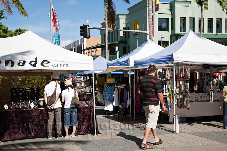 Tourists shopping at the weekend Esplanade Markets.  Cairns, Queensland, Australia