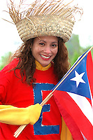 Performer age 29 with Puerto Rican flag at Cinco de Mayo.  St Paul Minnesota USA