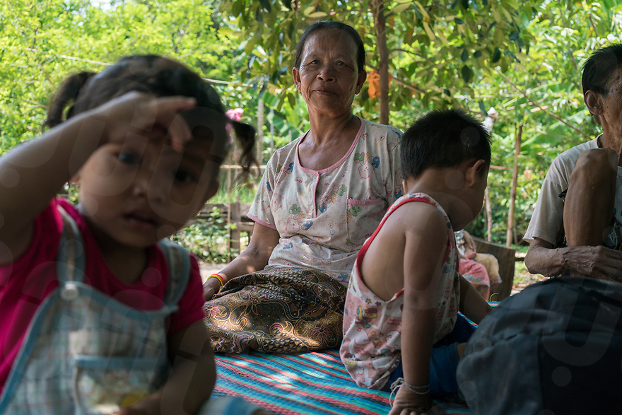 May 1st, 2017 - Nakasang (Laos). Spirit medium Phoutan seen at home. When not channelling a spirit, she is an ordinary grandmother. © Thomas Cristofoletti / Ruom