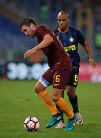Calcio, Serie A: Roma vs Inter. Roma, stadio Olimpico, 2 ottobre 2016.<br /> Roma&rsquo;s Kevin Strootman, left, is challenged by FC Inter&rsquo;s Joao Mario during the Italian Serie A football match between Roma and FC Inter at Rome's Olympic stadium, 2 October 2016.<br /> UPDATE IMAGES PRESS/Isabella Bonotto