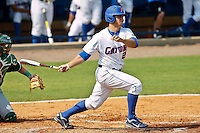 June 03, 2011:    Florida Gators inf/of Preston Tucker (25) follows through after hitting his first of two home runs during NCAA Gainesville Regional action between Manhattan Jaspers  and Florida Gators played at Alfred A. McKethan Stadium on the campus of Florida University in Gainesville, Florida.  Florida defeated Manhattan 17-3.........