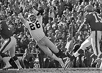 Oakland Raiders Skip Thomas dives to block kick by Denver Bronco Jim Turner. (1972 photo/Ron Riesterer)