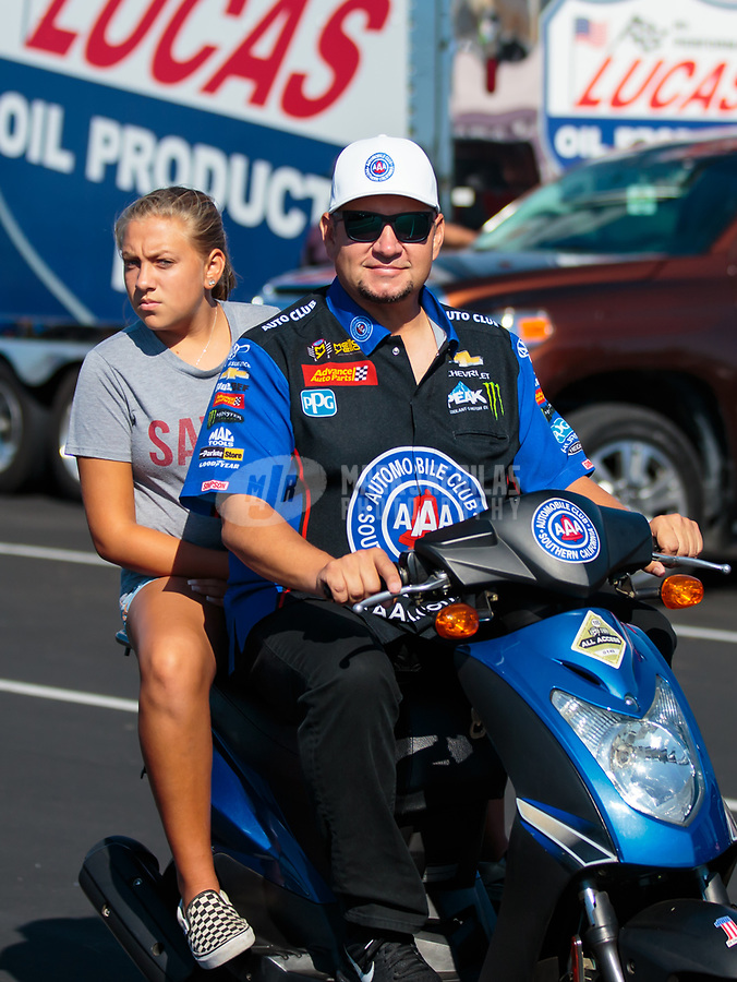 Sep 2, 2018; Clermont, IN, USA; NHRA funny car driver Robert Hight (right) with daughter Autumn Hight during qualifying for the US Nationals at Lucas Oil Raceway. Mandatory Credit: Mark J. Rebilas-USA TODAY Sports