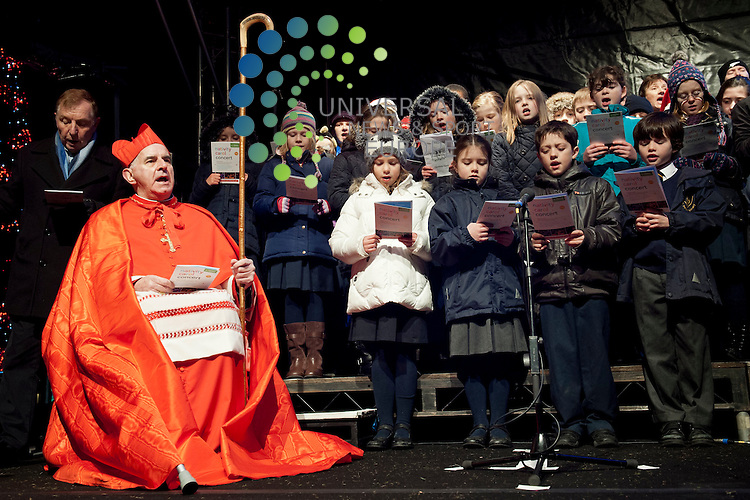 To mark the first Sunday of Advent, people gather to sing carols around Tim Chalk's Nativity Scene in St Andrew Square Garden in Edinburgh. Pictured Cardinal Keith Patrick O'Brien..Picture: Pavol Mraz/Universal News And Sport (Scotland). 2/ December 2012.