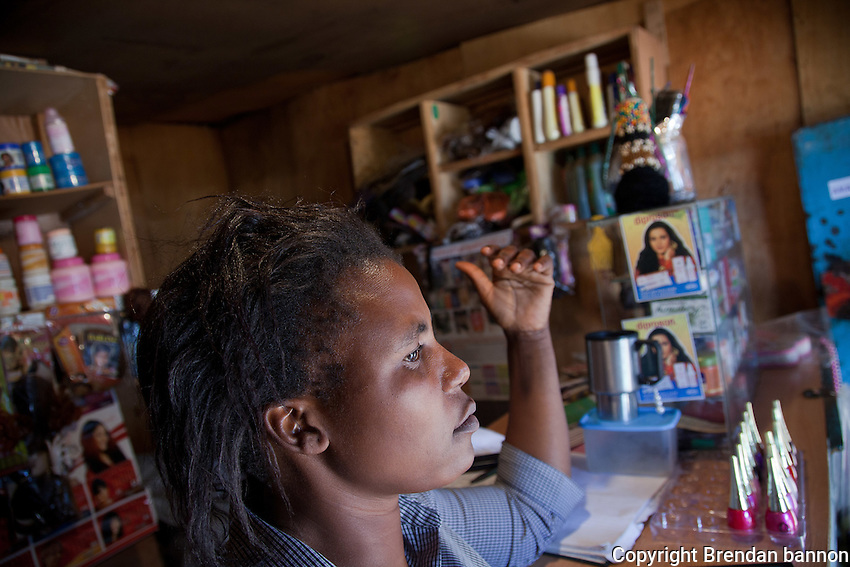 """Cynthia Achieng's Olympic Beauty Shop was destroyed following election violence in 2008, but she says """"you cannot dwell on mistakes which are not your fault"""". She has since expanded her business and says she is 'optimistic' for the future despite Kenya's """"always politicking""""."""