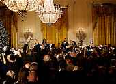 Israeli President Reuven Rivlin speaks at a Hanukkah reception in the East room of the White House while US President Barack Obama(2R), US First Lady Michelle Obama (2L), Nechama Rivlin, the wife of Reuven Rivlin (L) and Rabbi  Susan Talve (R) listen, in Washington, DC, December 9, 2015.  <br /> Credit: Aude Guerrucci / Pool via CNP