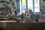 Barman pulling pints of beer Inside Gleneagles Bar pub at Mgarr, Gozo, Malta