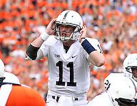 Penn State quarterback Matthew McGloin (11) calls a play during an NCAA college football game against Virginia in Charlottesville, Va. Virginia defeated Penn State 17-16.