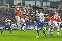 Players from both sides vie for the ball at a corner during Reading vs Luton Town, Sky Bet EFL Championship Football at the Madejski Stadium on 9th November 2019