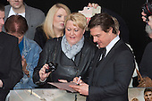 """Actor Tom Cruise with fans. First World Premiere of the new Tom Cruise and Emily Blunt movie """"Edge of Tomorrow"""" at the BFI IMAX cinema in London, United Kingdom. As the film is about reliving the events of one day over and over in an epic battle to save the world, the stars of """"Edge of Tomorrow"""" take part in a worldwide event when, for the first time ever, three fan premieres will be held in three different countries in just one day."""