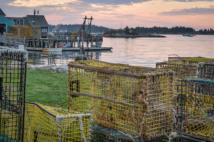 The traps lining the shore at Stonington Harbor are scenic reminders of the importance of the harbor to Maine's commercial fishing industry.