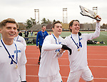 NEW BRITAIN, CT-111817JS08- Lewis Mills' Nick Lutrzykowski (7), Peter Christiano (10) and John Mudgett (14) walk around with their state champion plaque following their 3-2 win over Suffield in Class M state finals Saturday at Willow Brook Park in New Britain.<br /> Jim Shannon Republican-American