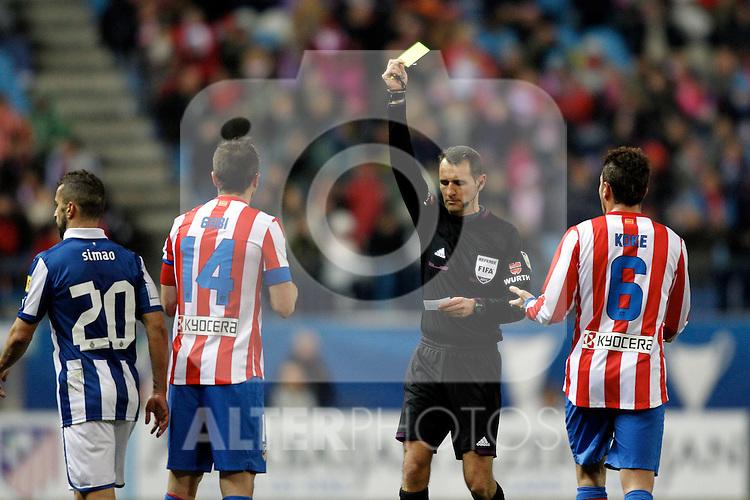Referee Clos Gomez, Atletico de Madrid's Gabi Fernandez (l), Koke and Espanyol's Simao during La Liga  match. February 24,2013.(ALTERPHOTOS/Alconada)