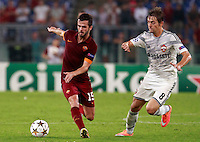 Calcio, Champions League, Gruppo E: Roma vs CSKA Mosca. Roma, stadio Olimpico, 17 settembre 2014.<br /> Roma midfielder Miralem Pjanic, of Bosnia, left, is challenged by CSKA Moskva forward Kirill Panchenko during the Group E Champions League football match between AS Roma and CSKA Moskva at Rome's Olympic stadium, 17 September 2014.<br /> UPDATE IMAGES PRESS/Isabella Bonotto