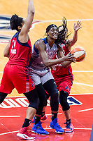 Washington, DC - Sept 17, 2017: Minnesota Lynx center Sylvia Fowles (34) goes up strong for a lay up against Washington Mystics center Krystal Thomas (34) and Washington Mystics guard Kristi Toliver (20) during playoff game between the Mystics and Lynx at the Verizon Center in Washington, DC. (Photo by Phil Peters/Media Images International)
