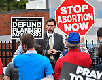 Brian Westbrook, executive director of Coalition for Life St. Louis, was one of the speakers at the rally. Students for Life of America and pro-life and anti-abortion advocates in Missouri and Illinois joined together to rally against Planned Parenthood at their new facility, 317 Salem Place in Fairview Heights, IL on October 9, 2019. Last week, Planned Parenthood announced it had been secretly constructing an updated facility in Illinois, 13 miles from the last existing facility in Missouri.                 <br />                             Photo by Tim Vizer