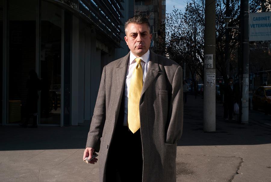 ROMANIA / 20.11.09 /Bucharest / A Business man in the Piata Victoriei area. © Davin Ellicson / Anzenberger
