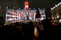 Folla in piazza del Campidoglio a Roma, 16 ottobre 2011, in occasione della Notte Tricolore per la celebrazione del 150esimo anniversario dell'Unita' d'Italia..Crowd in Piazza del Campidoglio square in Rome, 16 march 2011, in occasion of the Tricolour Night marking the 150th anniversary of the Italian Union..UPDATE IMAGES PRESS/Riccardo De Luca