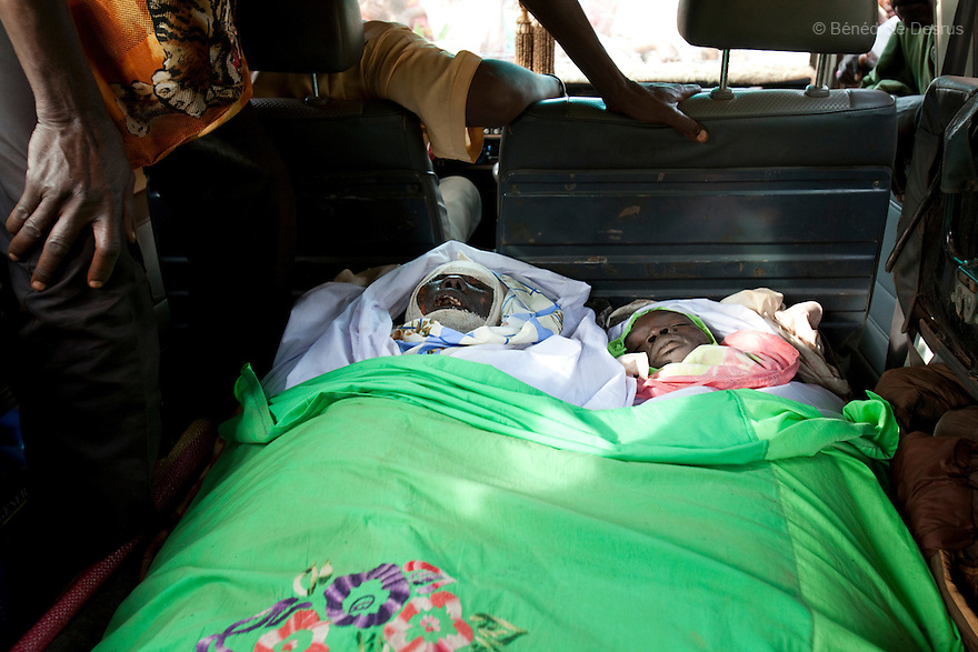 18 may 2010 - Yambio, Western Equatoria State, South Sudan - The bodies of Gabriel Makana, 49 years old (left) and Baraka Josefati, 25 years old (right) are arrived in Yambio. Three Sudanese were brutally murdered when their car was ambushed by the Lord's Resistance Army (LRA) on the road just few miles from Tambura on May 17, 2010. The victims were government officials in the State Ministry of Education: Mr. William Arkangelo Baabe, Mr. Gabriel Makana (49 years old) and Baraka Josefati (25 years old). Over the weekend 30 to 40 LRA attacked five miles north of the town of Tambura, close to the borders with the Central African Republic and the Democratic Republic of the Congo. The LRA group ransacked a medical center, looted food and other items, and abducted seven people. Western Equatoria state has been rocked by LRA activities since 2006. Thousands of people have been forced from their homes as brutal attacks continue against the civilian population in the region and neighboring DRC and CAR. Photo credit: Benedicte Desrus