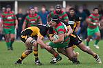 Kato Nganeko is tackled by Josh Chamberlain and Peter Mata. Counties Manukau Premier Club Rugby game between Waiuku and Bombay, played at Waiuku on Saturday July 5th 2010. Waiuku won 59 - 14 after trailing 12 - 14 at halftme.