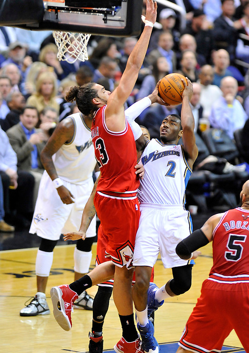 John Wall of the Wizards goes up for a layup against Joakim Noah of the Bulls. Chicago defeated Washington 105-77 at the Verizon Center in Washington, D.C. on Monday, February 28, 2011. Alan P. Santos/DC Sports  Box