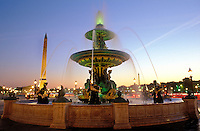 France, Paris, Place de la Concorde, fountain illuminated  at dusk