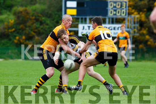 Dr Crokes GAvin White is picpockted by Kieran Donaghy and Fiachra Mangan Austin Stacks during their Club Championship clash in Killarney on Sunday