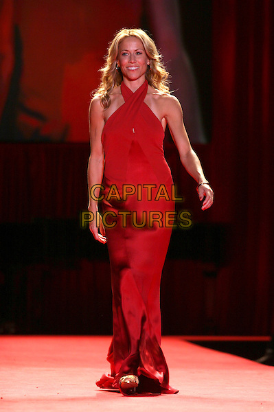 SHERYL CROW.The Heart Truth Red Dress Collection Fashion Show .The Olympus Fashion Week,.New York, New York, USA,.3rd February 2006..full length runway catwalk celebrity modelling .Ref: IW .www.capitalpictures.com.sales@capitalpictures.com.©Capital Pictures