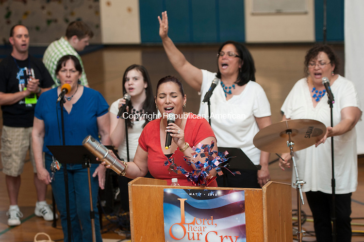 TORRINGTON, CT-7 May 2015-050715EC08-  Michelle Turnbull, with Grace Life Church in Torrington, sings with backup during a National Day of Prayer service Thursday night. About 50 gathered from seven Litchfield County ministries at Vogel-Wetmore School to mark the National Day of Prayer. The event included games for children, prayer, music, and pizza. Erin Covey Republican-American