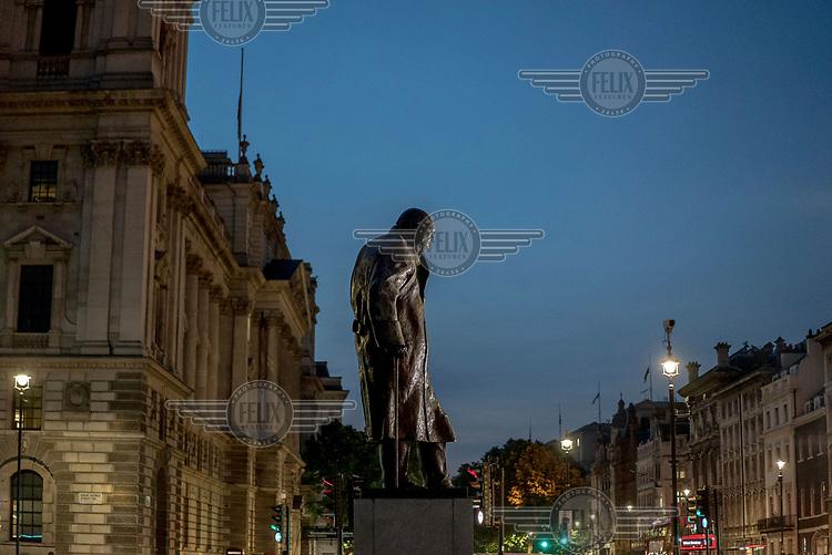 A statue of Winston Churchill in Parliament Square.