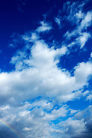 Clouds in a beautiful blue, sunny sky.
