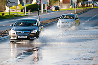 Thursday 02 January 2014<br /> Pictured:Traffic makes it's way through flood water on carmarthen's Coracle Way<br /> Re: The river that flows through the centre of Carmarthen has burst its banks after the recent bout of heavy rain.