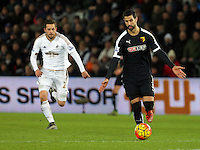 L-R Gylfi Sigurdsson of Swansea chasing Miguel Britos of Watford during the Barclays Premier League match between Swansea City and Watford at the Liberty Stadium, Swansea on January 18 2016
